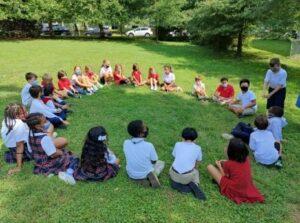 Students sitting together outside together