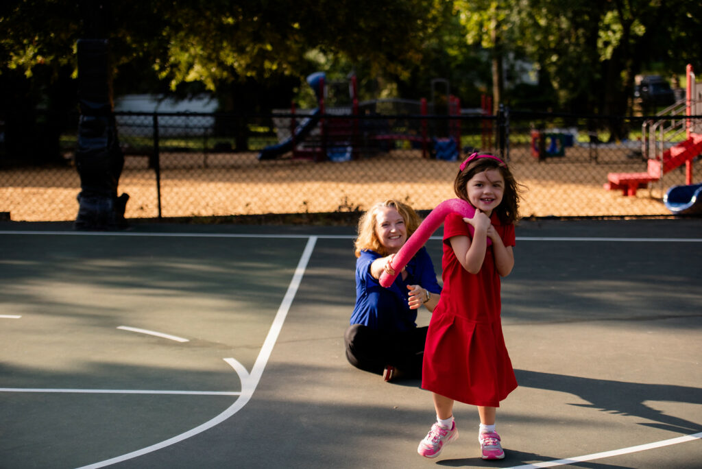 head of school playing with student at PE